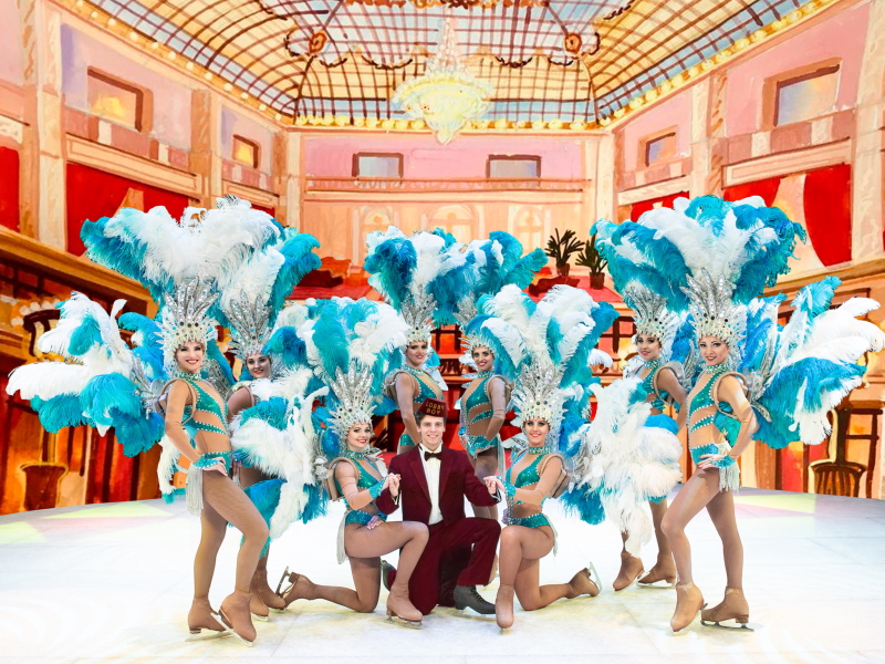 Circus on ice Grand Hotel lobby-boy wit feather girls on ice