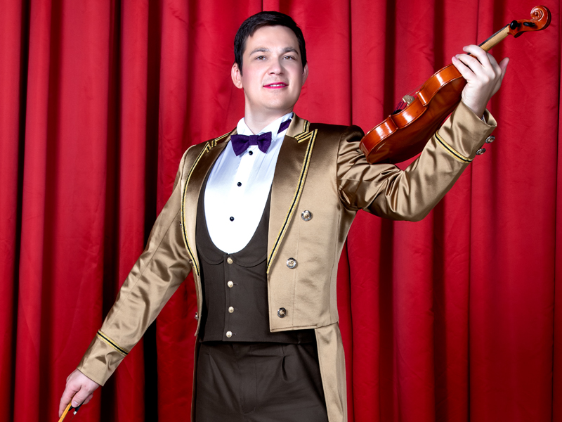 maitre d'hotel plays the violin at Grand Hotel by Moscow circus on ice
