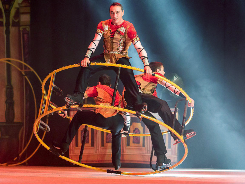 three guys on a german wheel in Grand Hotel Moscow circus on ice
